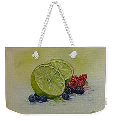 Weekender Tote Bag featuring the painting Lime And Berries by Kelly Mills