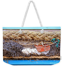 Weekender Tote Bag featuring the photograph Line Of Debris by Stephen Mitchell