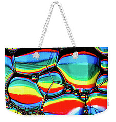 Weekender Tote Bag featuring the photograph Lined Bubbles by Jean Noren