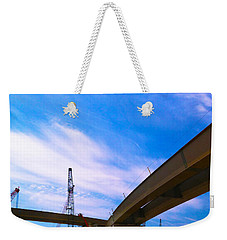 Weekender Tote Bag featuring the photograph Lineing The Sky by Jamie Lynn
