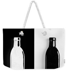 Weekender Tote Bag featuring the photograph Little Black  Bottle by Andrey  Godyaykin