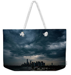Weekender Tote Bag featuring the photograph Little Manhattan Under A Cloud by Chris Lord