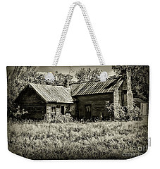 Weekender Tote Bag featuring the photograph Little Red Farmhouse In Black And White by Paul Ward