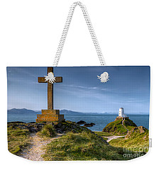 Weekender Tote Bag featuring the photograph Llanddwyn Cross by Adrian Evans