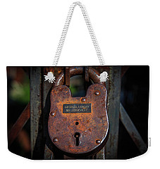 Weekender Tote Bag featuring the photograph Locked Up Tight by Doug Camara