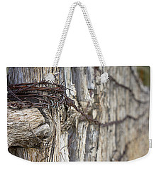 Weekender Tote Bag featuring the photograph Log And Wire Fence by Phyllis Denton