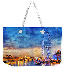 Weekender Tote Bag featuring the photograph London Eye by Ian Mitchell