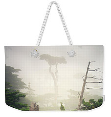 Weekender Tote Bag featuring the photograph Lone Cyprus Tree by Craig J Satterlee