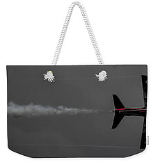Weekender Tote Bag featuring the photograph Lone Red Arrow Smoke Trail - Teesside Airshow 2016 by Scott Lyons