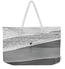 Weekender Tote Bag featuring the photograph Lone Surfer by Nicholas Burningham