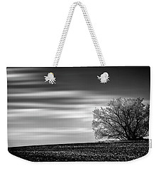 Weekender Tote Bag featuring the photograph Lone Tree by Dan Jurak
