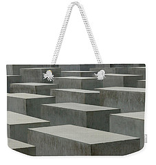 Weekender Tote Bag featuring the photograph Loneliness, Powerlessness And Despair by Geoff Smith