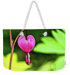 Weekender Tote Bag featuring the photograph Lonely Heart by Jessica Manelis