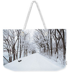 Lonely Snowy Road Weekender Tote Bag by  Newwwman