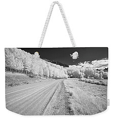 Weekender Tote Bag featuring the photograph Long Road In Colorado by Jon Glaser