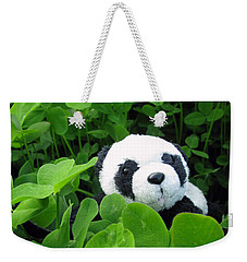 Weekender Tote Bag featuring the photograph Looking For A Lucky Clover by Ausra Huntington nee Paulauskaite