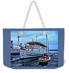 Weekender Tote Bag featuring the photograph Lotus And The Dinghies by Thom Zehrfeld