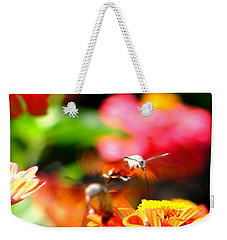 Weekender Tote Bag featuring the photograph Lucky Shot by Ana Maria Edulescu