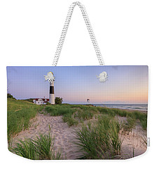 Weekender Tote Bag featuring the photograph Ludington Beach And Big Sable Point Lighthouse by Adam Romanowicz