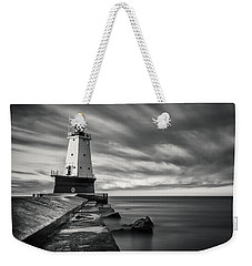 Weekender Tote Bag featuring the photograph Ludington Light Black And White by Adam Romanowicz