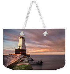 Weekender Tote Bag featuring the photograph Ludington Light Sunrise Long Exposure by Adam Romanowicz