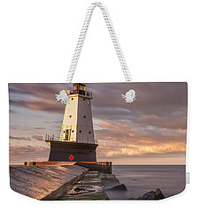 Weekender Tote Bag featuring the photograph Ludington North Breakwater Light At Dawn by Adam Romanowicz