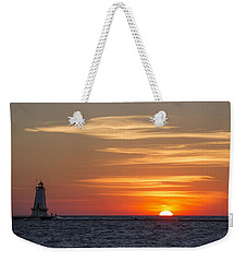 Weekender Tote Bag featuring the photograph Ludington North Breakwater Light At Sunset by Adam Romanowicz