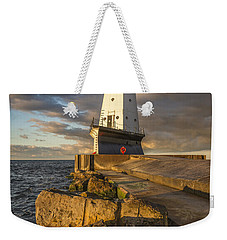 Weekender Tote Bag featuring the photograph Ludington North Breakwater Lighthouse At Sunrise by Adam Romanowicz