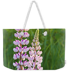 Weekender Tote Bag featuring the photograph Lupine Pair by Paul Miller