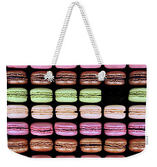 Weekender Tote Bag featuring the photograph Macarons - One Missing by Nikolyn McDonald
