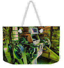Weekender Tote Bag featuring the photograph Machinery In An Old Grist Mill by Jeff Swan