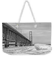 Weekender Tote Bag featuring the photograph Mackinac Bridge Icy Black And White  by John McGraw