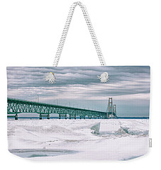 Weekender Tote Bag featuring the photograph Mackinac Bridge In Winter During Day by John McGraw