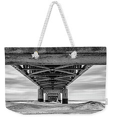 Weekender Tote Bag featuring the photograph Mackinac Bridge In Winter Underneath  by John McGraw