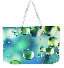 Weekender Tote Bag featuring the photograph Macro Water Droplets Aquamarine Soft Green Citron And Blue by Sharon Mau