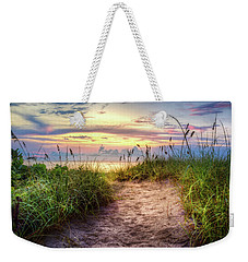 Weekender Tote Bag featuring the photograph Magical Light In The Dunes by Debra and Dave Vanderlaan