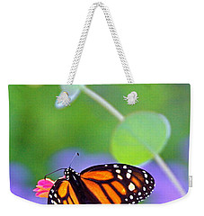 Weekender Tote Bag featuring the photograph Magical Monarch by Byron Varvarigos
