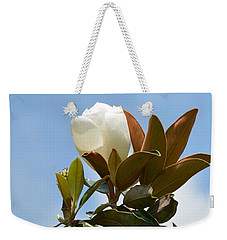 Weekender Tote Bag featuring the photograph Magnolia Topper by Maria Urso