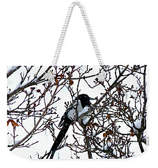 Weekender Tote Bag featuring the photograph Magpie In A Snowstorm by Will Borden