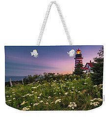 Weekender Tote Bag featuring the photograph Maine West Quoddy Head Lighthouse Sunset by Ranjay Mitra