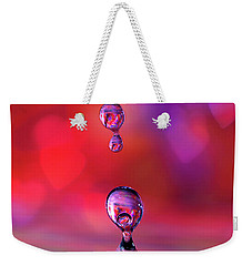 Weekender Tote Bag featuring the photograph Making A Splash by Darren Fisher