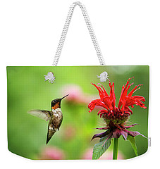 Male Ruby-throated Hummingbird Hovering Near Flowers Weekender Tote Bag