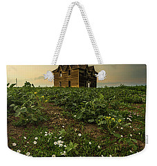 Weekender Tote Bag featuring the photograph Mammatus And Flowers  by Aaron J Groen