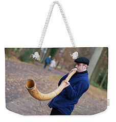 Weekender Tote Bag featuring the photograph Man Blowing Horn by Hans Engbers