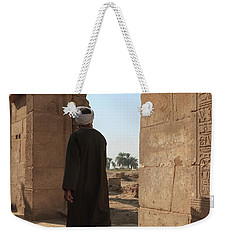 Weekender Tote Bag featuring the photograph Man In The Temple by Silvia Bruno
