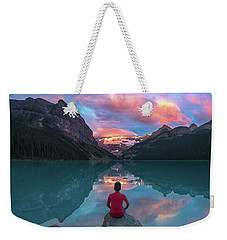 Weekender Tote Bag featuring the photograph Man Sit On Rock Watching Lake Louise Morning Clouds With Reflect by William Lee