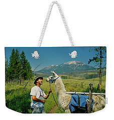 Man Teasing A Llama Weekender Tote Bag by Jerry Voss