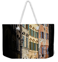 Man Walking Alone In Small Street In Siena, Tuscany, Italy Weekender Tote Bag
