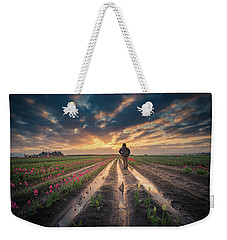 Weekender Tote Bag featuring the photograph Man Watching Sunrise In Tulip Field by William Lee