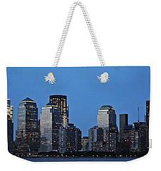 Weekender Tote Bag featuring the photograph Manhattan Skyline by John Haldane
